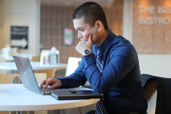 man works on computer with concerned look